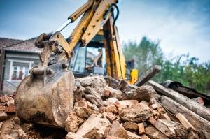 Hydraulic crusher excavator backoe machinery working on site
