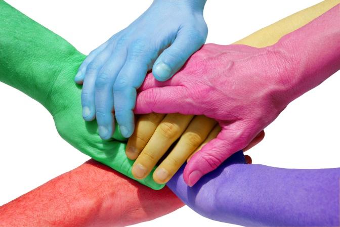 many hands symbolizing teamwork/power/unity/equality