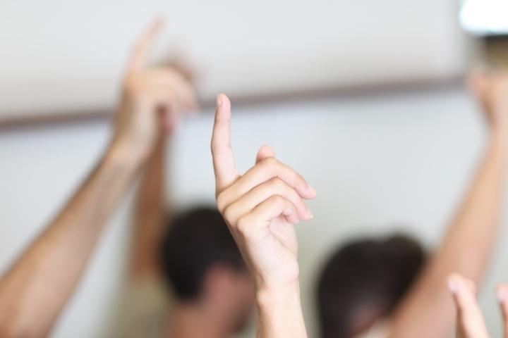 volunteers with hands up