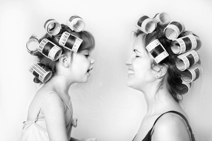 vintage image of a mother and daughter wearing rollers in their hair and having a good time